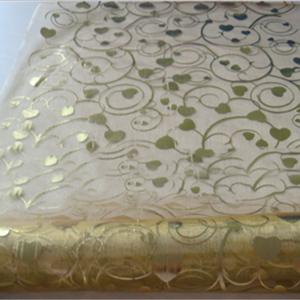 swirls gold fabric